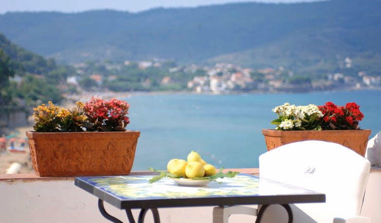 Palazzo Belmonte Amalfi Coast terrace outdoor seating overlooking sea bowl of lemons