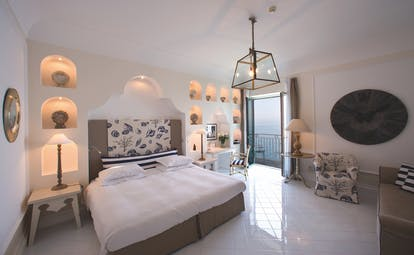 Bellevue Syrene  Amalfi Coast deluxe sea view room bed balcony overlooking the sea