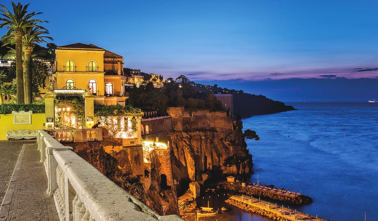 Bellevue Syrene Amalfi Coast hotel exterior by night hotel on cliffside overlooking the sea