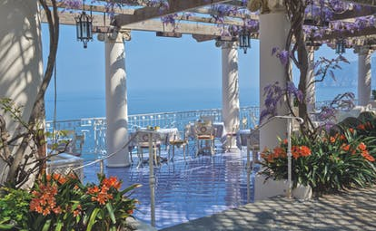 Bellevue Syrene Amalfi Coast pergola terrace outdoor dining overlooking the sea