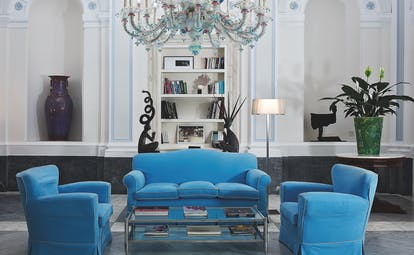 Bellevue Syrene Amalfi Coast reception interior colourful candelabra sofas and armchairs