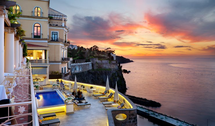 Bellevue Syrene Amalfi Coast terrace pool sun loungers overlooking the sea