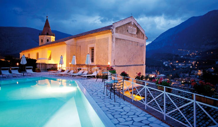 La Locanda Delle Donne Monache Basilicata exterior at night hotel building pool mountains in background