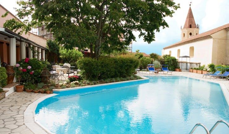 La Locanda Delle Donne Monache Basilicata pool sun loungers hotel building