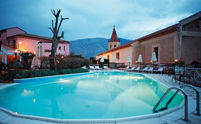 La Locanda Delle Donne Monache Basilicata pool and terrace sun loungers umbrellas