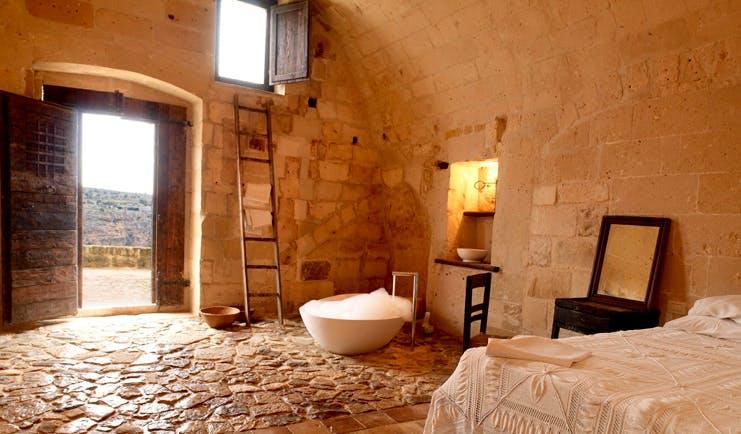 Sextantio Le Grotte Della Civita Basilicata cave guest room authentic architecture