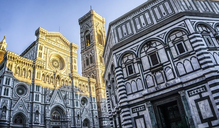 The contrasting stone of black and white of the exterior of Florence's cathedral and bapistry