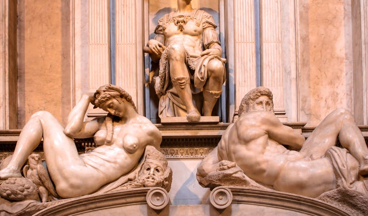 Michelangelo's sculptures of night and day on the marble tomb of Giuliano de Medici in Florence
