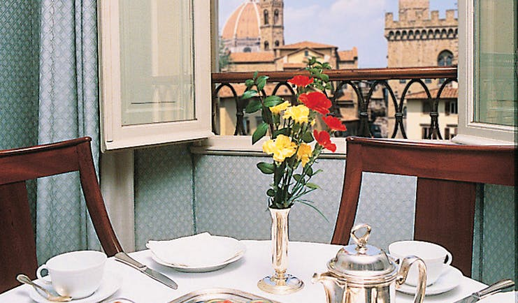 Hotel Bernini Palace Florence deluxe room breakfast table set by window cathedral views