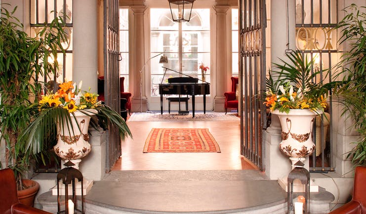 Relais Santa Croce Florence entrance hall baby grand piano marble floors