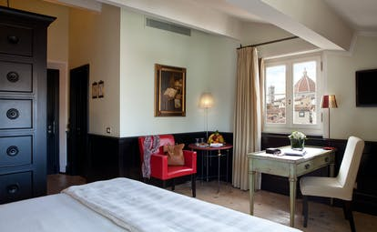 Relais Santa Croce Florence grand deluxe room bed desk window with partial Duomo view