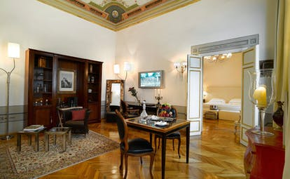 Relais Santa Croce Florence royal suite lounge area leading to bedroom