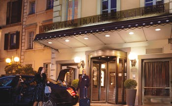 Entrance to the hotel at night from the outside showing revolving doors to ente