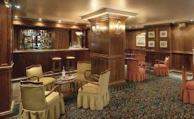 Hotel de la Ville Milan bar indoor seating traditional décor