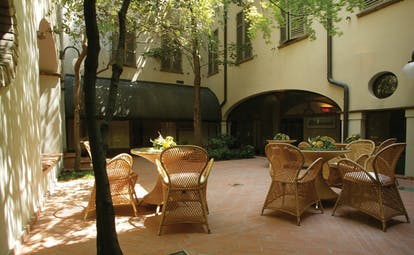 Palace Hotel Maria Luigia Parma courtyard outdoor seating area trees