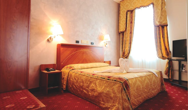 Rechigi Park Hotel guestroom, double bed, draped curtains, traditional decor
