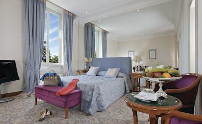 Aldrovandi Villa Borghese Rome deluxe bedroom bed furniture mirrored wall