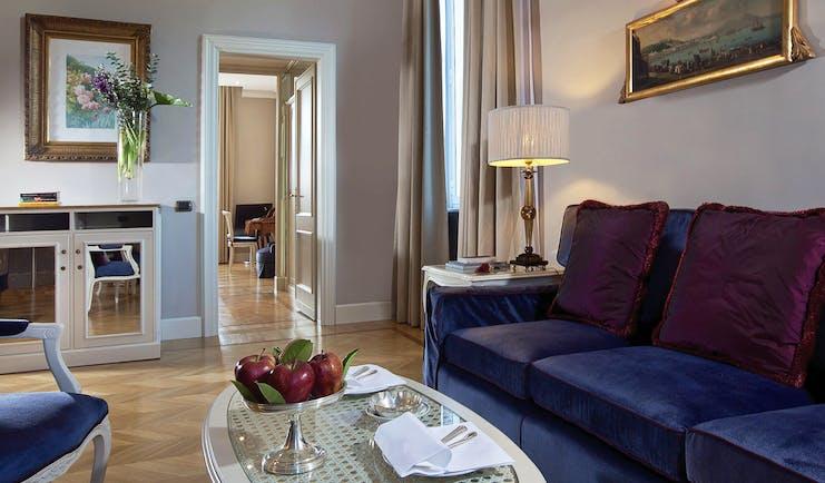 Aldrovandi Villa Borghese Rome executive suite lounge sofa door leading to bedroom