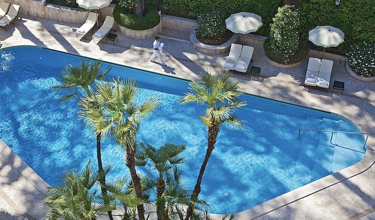 Aldrovandi Villa Borghese Rome pool sun loungers umbrellas