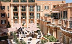 Hotel de la Villa Rome orange building with green shutter and umbrellas