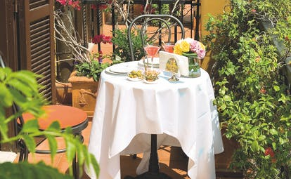 Hotel d'Inghilterra Rome balcony private seating and dining area shrubs and trees