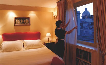 Hotel d'Inghilterra Rome junior suite bed maid city views