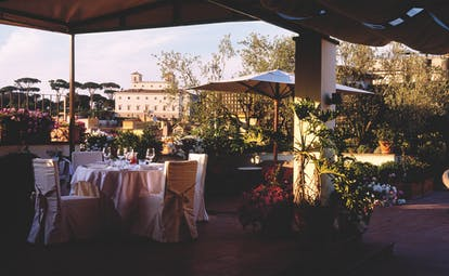 Hotel d'Inghilterra Rome outdoor dining plants umbrella city views