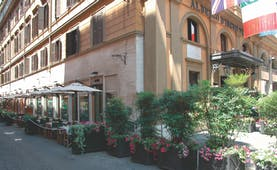 Hotel d'Inghilterra Rome street terrace outdoor dining area umbrellas