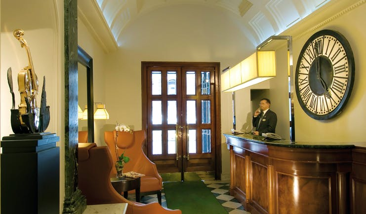 Reception area with doors to exit and man behind the desk