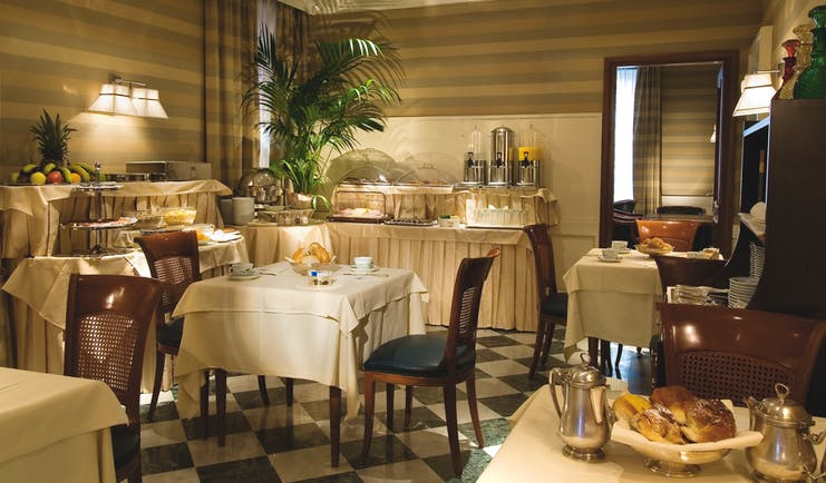 Hotel Mascagni Rome restaurant indoor dining area food modern décor