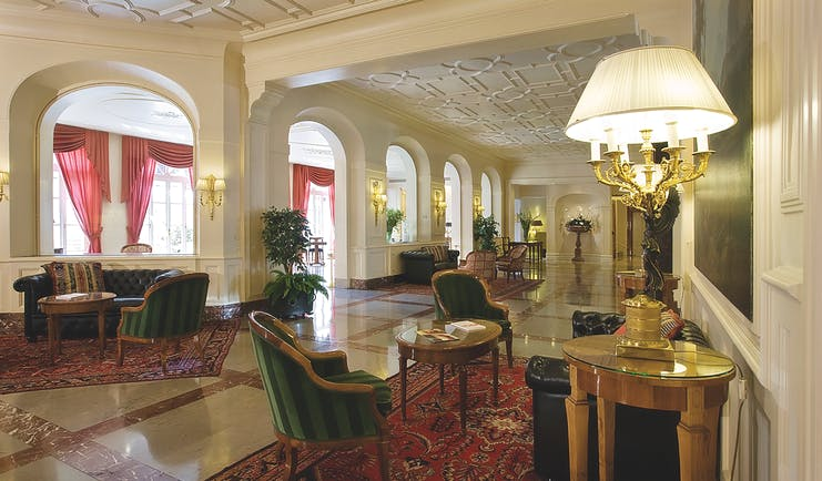 Grand Hotel Sitea Turin lobby hall with seating and antique lights