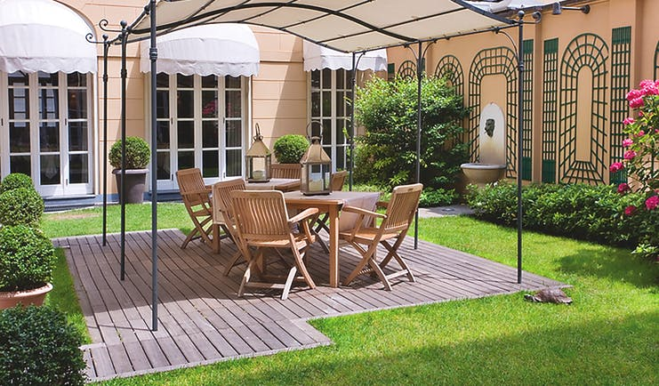 Grand Hotel Sitea Turin garden area with shade and chairs by grass