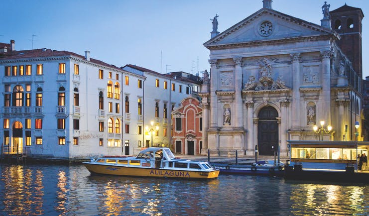 Palazzo Giovanelli Venice hotel building on canal front adjacent to church