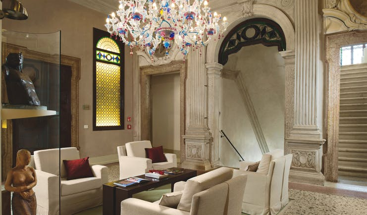 Palazzo Giovanelli Venice lounge communal indoor seating area marble floors candelabra