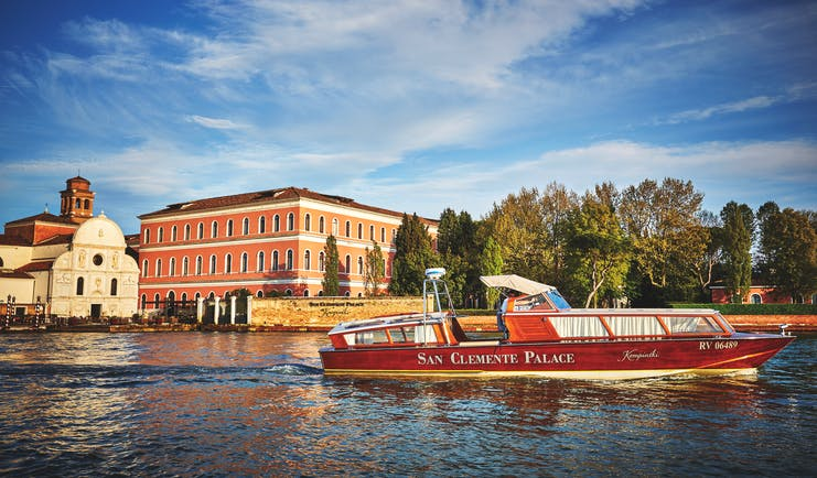 San Clemente Palace Venice hotel exterior view from canal boat on water