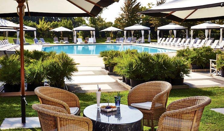 San Clemente Palace Venice pool sun loungers umbrellas outdoor dining area