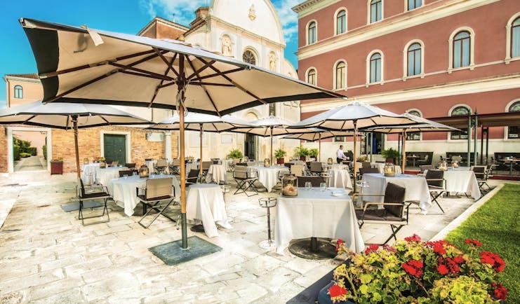 San Clemente Palace Venice terrace outdoor dining umbrellas