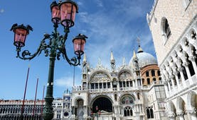 Iron lamp outside St Mark's Basilica and pink Doge's Palace in Venice