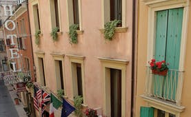 Hotel Giulietta e Romeo Verona hotel building exterior traditional architecture international flags