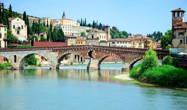 Roman stone bridge over the blue waters of the river Adige in Verona