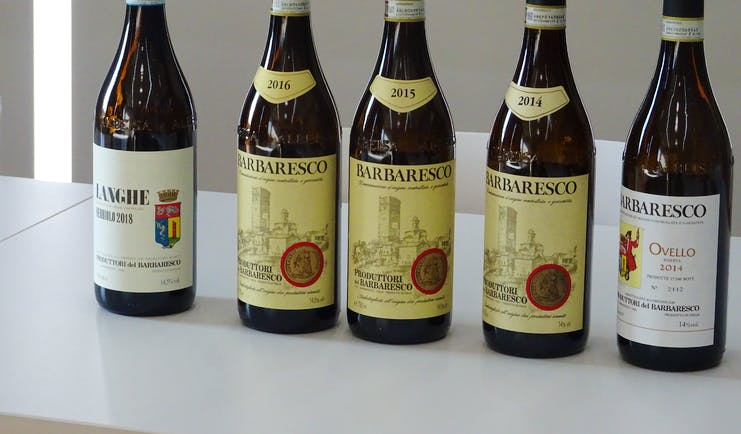 Row of red wine Barbaresco bottles