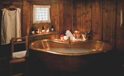Hotel Bellevue Italy Alps spa bath brass roll top bath candlelit room