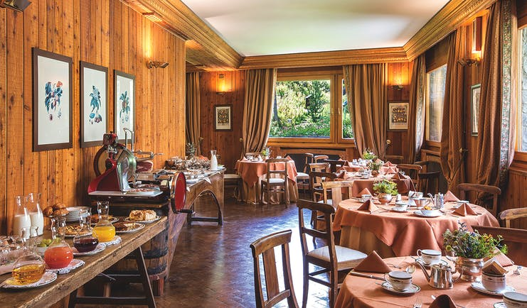 Hotel Hermitage Italy Alps breakfast buffet dining area continental breakfast