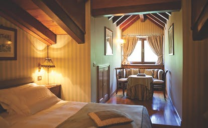 Hotel Hermitage Italy Alps classic  attic room bed seating area