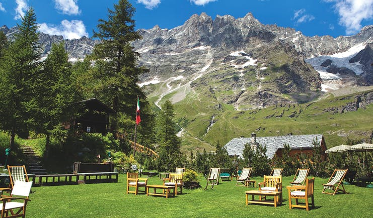 Hotel Hermitage Italy Alps gardens lawn outdoor seating mountains