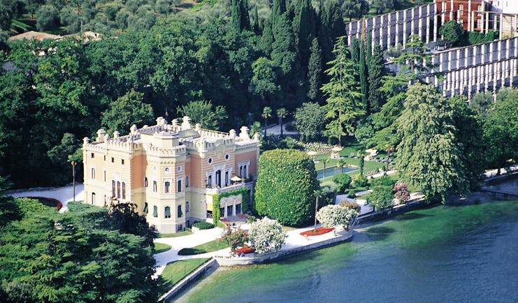 Villa Feltrinelli Lake Garda aerial exterior hotel building lawns trees overlooking lake