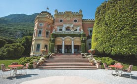 Villa Feltrinelli Lake Garda exterior hotel building steps leading to entrance outdoor seating