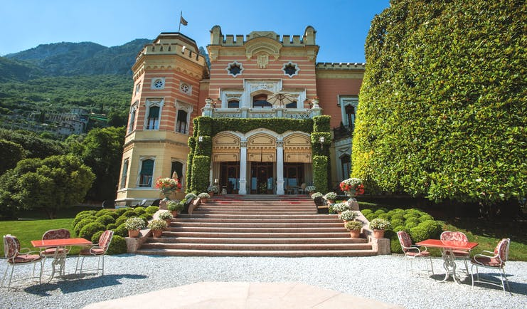 Villa Feltrinelli Lake Garda exterior hotel building steps leading to entrance outdoor seating