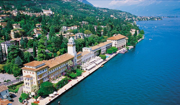 Grand Hotel Gardone birds eye view of the exterior showing the large hotel on the edge of a blue italian lake