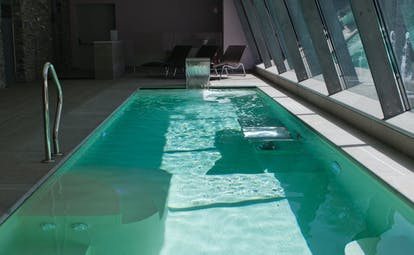Spa massage ppool with window pannelled slanted walls